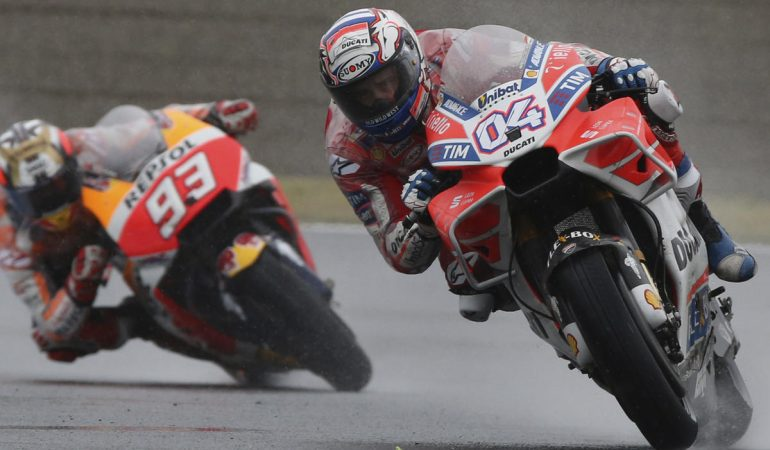 Italy's Andrea Dovizioso steers his Ducati tailed by Spain's Marc Marquez on Honda on the way to winning the MotoGP Japanese Motorcycle Grand Prix at the Twin Ring Motegi circuit in Motegi, north of Tokyo, Sunday, Oct. 15, 2017. Marquez finished second. (AP Photo/Shizuo Kambayashi)
